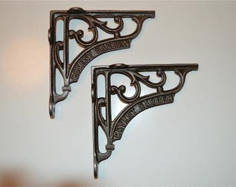 A pair of antique style Covent Garden cast iron shelf brackets