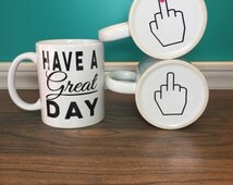 JUST IN! The classic coffee cup , 11oz the perfect c handle  the perfect prank coffee cup. Have a great day with the middle finger