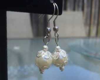 Glass pearl and silver earrings
