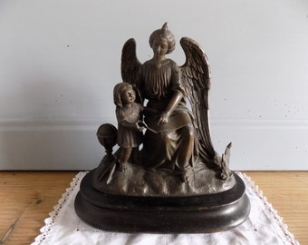 Lovely French vintage spelter statue of angel and child on wooden mount, early 1900s.