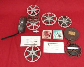 Vintage Keystone 8mm Movie Camera Model K-8 and 7 films Mickey Mouse Charle Chaplin Little Rascals and Popeye