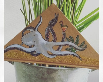 Hand-illustrated octopus notebook , triangle shaped.