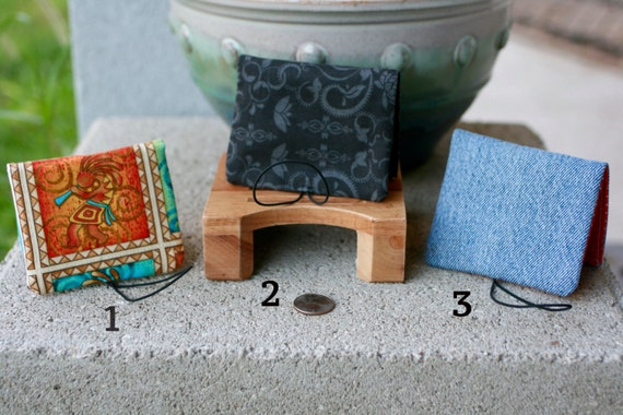 Pocket Wallet women's or men's with elastic strap of various colors and designs each sold separately