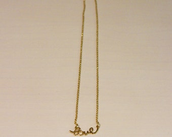 Love necklace, necklace mounted in Silver chain. Necklace mounted in Gold chain.