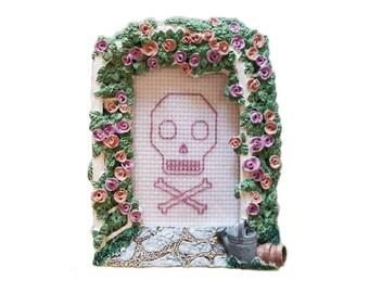 Pink Skull and Crossbones framed cross stitch