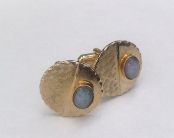 Vintage gold tone and faux opal cufflinks.