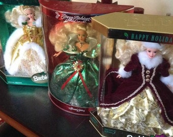 Lot of 3 Holiday Barbie Dolls - Special Editions.  Barbies are from 1994, 1995 and 1996. MINT! UNUSED condition in original boxes.