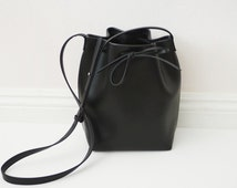 Ships next day Stiff black faux leather bucket bag with no top stitches
