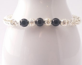 Black glass pearls and silver filigree metal beads on a full persian chain maille bracelet