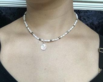 Sad Cherub Necklace