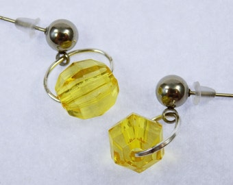 Earrings with yellow beads and earrings made of stainless steel