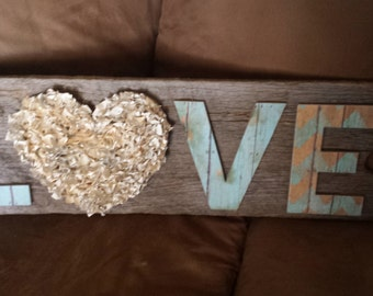 LOVE sign on old barn wood
