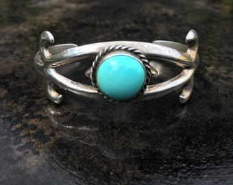 Cast sterling cuff bracelet with turquoise cabochon