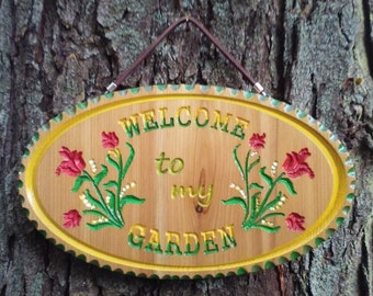 Welcome to my Garden.  Cedar oval, 5-color hand painted with leather hanger
