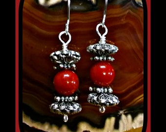 Red Coral dangle earrings fastened with Silver