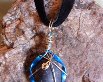 Large black with white speckles wire wrapped tumbled stone
