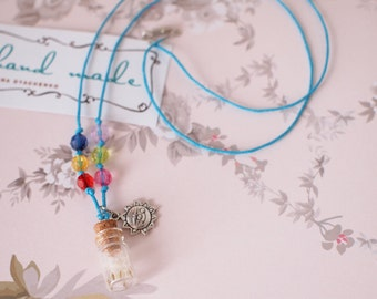 Tiny glass bottle necklace with blow-ball seed