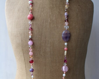 Necklace pink and purple made of stones and glass beads.