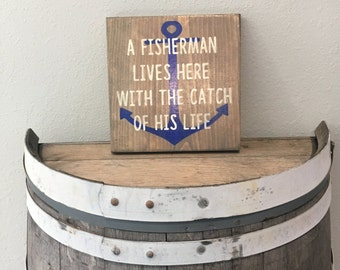A Fisherman lives here with the catch of his life sign/Lake Home Decor