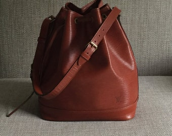 Louis Vuitton vintage Epi leather large Noe bucket bag - Brown / Cipango Gold