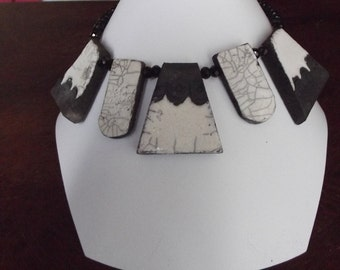 Necklace ceramic raku black and white with black glass pearls faceted