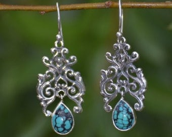 Extravagant Sterling Silver Earrings with Dangling Turquoise Gemstone