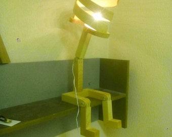 Lamp carries book