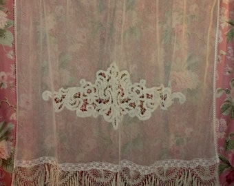 In old fabric, tulle and old lace curtain