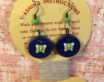 Tiny green butterfly earrings vintage packaging vintage clothing tag navy blue and green