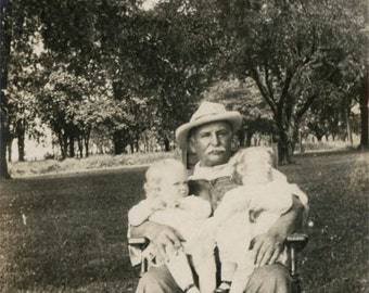 vintage photo 1912 FArmer Overall Grandfather Holds Two Baby Girls Rocking chair