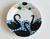 Swans gathering plate