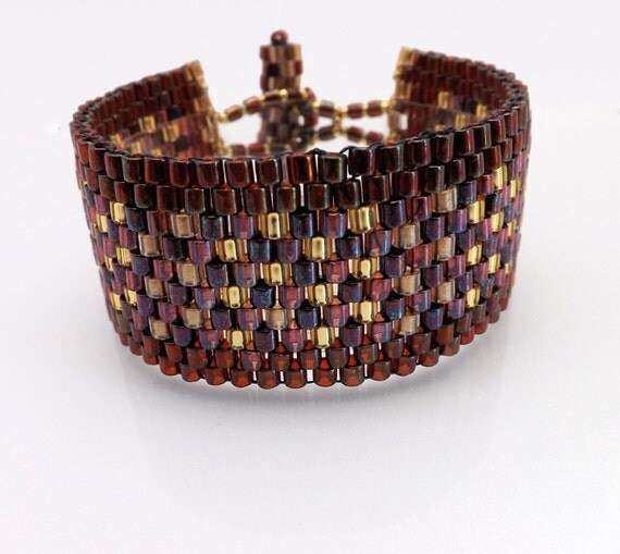 Peyote Stitch Bracelet- Reds, Gold, - Cuff style- 1 inch wide-7 1/4 long SKU: BR1007