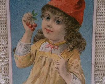 Long Haired Girl Holding Cherries-1889 Blank Victorian Trade Card Scrap