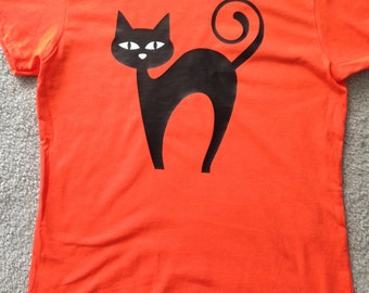 Halloween shirt, glow-in-the-dark tee, black cat shirt, orange t shirt, adult youth sizes, halloween cat, glowing eyes shirt, halloween gift
