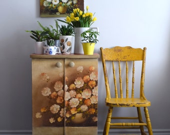 Decoupaged floral cabinet