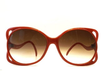 vintage 80's womens sunglasses cherry red oversized large plastic frames fashion accessories modern curvy arms cut-out square round brown