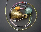 Indian Temple bell with colourful glassbeads ...