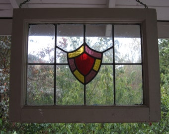 Vintage Stained Glass Window with Center Sheild Design in Pebbled Glass