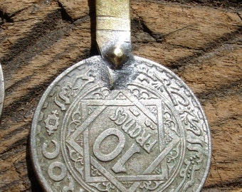 Moroccan 10 franc tarnished coin with brass loop or bail