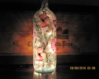 Wine bottle with pink, white Pansies, green leaves white baby breath, hand painted, lights inside