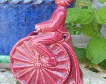 vintage bicycle man on antique 1800's bike Penney Farthing planter