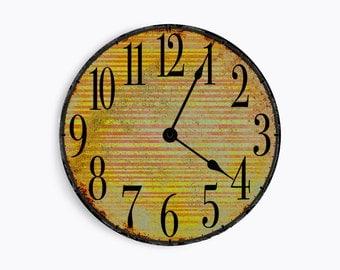 Striped orange and yellow wall clock. Circle design.