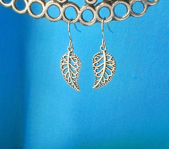 Decorative silver leaf dangle earrings.