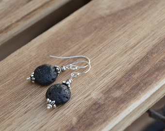 Organic black lava dangle earrings with silver accents.