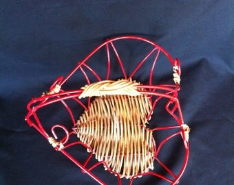 A Coated Red Wire And Straw/Rattan Heart Shaped Basket