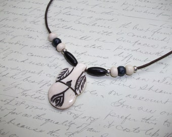 Native art style leather necklace