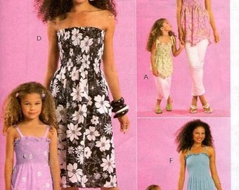 Clearance!!!!!  Misses, Childrens and Girls Tops and Dress. One Size Fits All.. McCalls M5639. New and uncut.