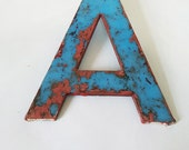 Small vintage sign letter A -  in blue plastic. Industrial letter, vintage marquee letter.