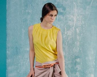 Bright yellow rayon top, folded neckline, sleeveless