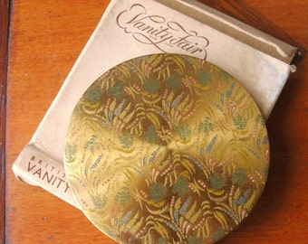 """1940's/50's +ORIGINAL cardboard BOX  by C. BLACKMORE-Very pretty ladies compact -""""goldtone""""col. metal/-attrac.design.One owner. Some damage."""